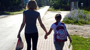 RESTRICTED TO EDITORIAL USE Alicja Pietrucha (R) and her mother Ilona are seen on their way to primary school on June 14, 2013 Kuligow, Poland. AFP PHOTO/JANEK SKARZYNSKI        (Photo credit should read JANEK SKARZYNSKI/AFP/Getty Images)