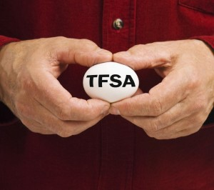 : TFSA ON WHITE NEST EGG HELD BY MAN'S HANDS by Habman18