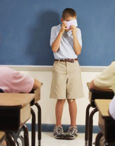 Shy Student Hiding Behind Note Cards During Class Presentation --- Image by © Randy Faris/Corbis